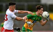15 May 2021; Ciaran Thompson of Donegal and Michael McKernan of Tyrone during the Allianz Football League Division 1 North Round 1 match between Tyrone and Donegal at Healy Park in Omagh, Tyrone. Photo by Stephen McCarthy/Sportsfile