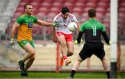 15 May 2021; Conor McKenna of Tyrone in action against Neil McGee and Donegal goalkeeper Shaun Patton during the Allianz Football League Division 1 North Round 1 match between Tyrone and Donegal at Healy Park in Omagh, Tyrone. Photo by Stephen McCarthy/Sportsfile