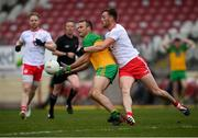 15 May 2021; Neil McGee of Donegal in action against Brian Kennedy of Tyrone during the Allianz Football League Division 1 North Round 1 match between Tyrone and Donegal at Healy Park in Omagh, Tyrone. Photo by Stephen McCarthy/Sportsfile
