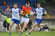 15 May 2021; Darragh Foley of Carlow in action against Mark Cummins, left, and Jason Curry of Waterford during the Allianz Football League Division 3 North Round 1 match between Waterford and Carlow at Fraher Field in Dungarvan, Waterford. Photo by Matt Browne/Sportsfile