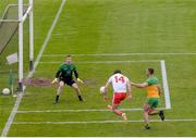 15 May 2021; Conor McKenna of Tyrone has a shot on Donegal goalkeeper Shaun Patton while being tracked by Neil McGee, right, during the Allianz Football League Division 1 North Round 1 match between Tyrone and Donegal at Healy Park in Omagh, Tyrone. Photo by Stephen McCarthy/Sportsfile