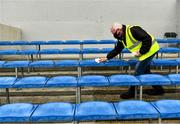16 May 2021; Clare official Martin Keane sanitises seats in advance of players arriving for the Allianz Hurling League Division 1 Group B Round 2 match between Clare and Wexford at Cusack Park in Ennis, Clare. Photo by Ray McManus/Sportsfile