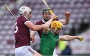 16 May 2021; Séamus Flanagan of Limerick is tackled by Gearóid McInerney, left, and Padraic Mannion of Galway during the Allianz Hurling League Division 1 Group A Round 2 match between Galway and Limerick at Pearse Stadium in Galway. Photo by Piaras Ó Mídheach/Sportsfile