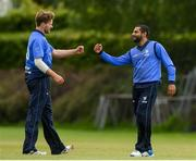 20 May 2021; Simi Singh of Leinster Lightning is congratulated by Barry McCarthy after making a catch to dismiss Seamus Lynch of Munster Reds during the Cricket Ireland InterProvincial Cup 2021 match between Leinster Lightning and Munster Reds at Pembroke Cricket Club in Dublin. Photo by Matt Browne/Sportsfile