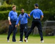 20 May 2021; Simi Singh of Leinster Lightning is congratulated by team captain George Dockrell, right,  and Barry McCarthy after making a catch to dismiss Seamus Lynch of Munster Reds during the Cricket Ireland InterProvincial Cup 2021 match between Leinster Lightning and Munster Reds at Pembroke Cricket Club in Dublin. Photo by Matt Browne/Sportsfile