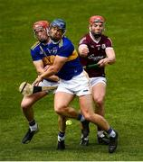 22 May 2021; TJ Brennan of Galway in action against Tipperary players Niall O'Meara, left, and John McGrath during the Allianz Hurling League Division 1 Group A Round 3 match between Tipperary and Galway at Semple Stadium in Thurles, Tipperary. Photo by Ray McManus/Sportsfile