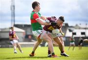 22 May 2021; Ronan O'Toole of Westmeath in action against Cillian O'Connor of Mayo during the Allianz Football League Division 2 North Round 2 match between Westmeath and Mayo at TEG Cusack Park in Mullingar, Westmeath. Photo by Stephen McCarthy/Sportsfile