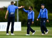 22 May 2021; David O'Halloran of Leinster Lighting celebrates with team-mate Simi Singh after bowling out Jack Carty of Munster Reds during the Cricket Ireland InterProvincial Cup 2021 match between Munster Reds and Leinster Lightning at Pembroke Cricket Club in Dublin. Photo by Harry Murphy/Sportsfile