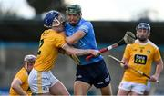 22 May 2021; Chris Crummey of Dublin is tackled by Damon McMullan of Antrim during the Allianz Hurling League Division 1 Round 3 match between Dublin and Antrim in Parnell Park in Dublin. Photo by Brendan Moran/Sportsfile