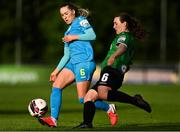 22 May 2021; Lucy McCartan of Peamount United clears under pressure from Fiona Donnelly of DLR Waves during the SSE Airtricity Women's National League match between DLR Waves and Peamount United at UCD Bowl in Belfield, Dublin. Photo by Sam Barnes/Sportsfile