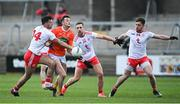 22 May 2021; Connaire Mackin of Armagh in action against Tyrone players, from left, Conor McKenna, Niall Sludden and Liam Rafferty, during the Allianz Football League Division 1 North Round 2 match between Armagh and Tyrone at Athletic Grounds in Armagh. Photo by Ramsey Cardy/Sportsfile