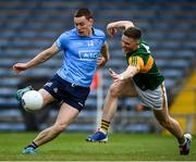 23 May 2021; Con O'Callaghan of Dublin takes a shot on goal despite the efforts of Jason Foley of Kerry during the Allianz Football League Division 1 South Round 2 match between Dublin and Kerry at Semple Stadium in Thurles, Tipperary. Photo by Stephen McCarthy/Sportsfile