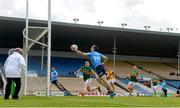 23 May 2021; Con O'Callaghan of Dublin palms the ball against the post watched by Paul Murphy of Kerry during the opening moments of the Allianz Football League Division 1 South Round 2 match between Dublin and Kerry at Semple Stadium in Thurles, Tipperary. Photo by Stephen McCarthy/Sportsfile