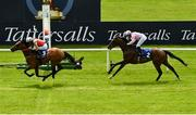 23 May 2021; Earlswood, left, with Ben Coen up, passes the post to win the Heider Family Stables Gallinule Stakes, from second place Arturo Toscanini, with Wayne Lordan up, during day two of the Tattersalls Irish Guineas Festival at The Curragh Racecourse in Kildare. Photo by Seb Daly/Sportsfile