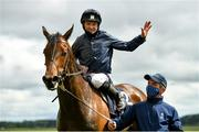 23 May 2021; Jockey Seamie Heffernan and groom Trevor O'Neill celebrate with Empress Josephine following victory in the Tattersalls Irish 1,000 Guineas during day two of the Tattersalls Irish Guineas Festival at The Curragh Racecourse in Kildare. Photo by Seb Daly/Sportsfile