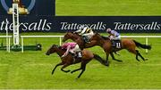 23 May 2021; Baby Zeus, 8, with Colin Keane up, passes the post ahead of second place Mirann, far side, with Ben Coen up, to win the Betway Guineas Festival Handicap during day two of the Tattersalls Irish Guineas Festival at The Curragh Racecourse in Kildare. Photo by Seb Daly/Sportsfile