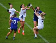 23 May 2021; Grace Clifford of Kildare wins possession ahead of Fiona Dooley of Laois during the Lidl Ladies Football National League Division 3B Round 1 match between Laois and Kildare at MW Hire O'Moore Park in Portlaoise, Laois. Photo by Piaras Ó Mídheach/Sportsfile