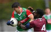 22 May 2021; Tommy Conroy of Mayo is tackled by Boidu Sayeh of Westmeath during the Allianz Football League Division 2 North Round 2 match between Westmeath and Mayo at TEG Cusack Park in Mullingar, Westmeath. Photo by Stephen McCarthy/Sportsfile