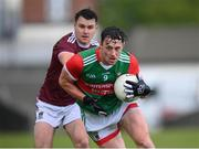 22 May 2021; Diarmuid O'Connor of Mayo in action against David Lynch of Westmeath during the Allianz Football League Division 2 North Round 2 match between Westmeath and Mayo at TEG Cusack Park in Mullingar, Westmeath. Photo by Stephen McCarthy/Sportsfile
