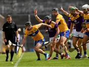 16 May 2021; Ian Galvin of Clare fails to hold the sliotar ahead of Kevin Foley of Wexford and players from both sides during the Allianz Hurling League Division 1 Group B Round 2 match between Clare and Wexford at Cusack Park in Ennis, Clare. Photo by Ray McManus/Sportsfile