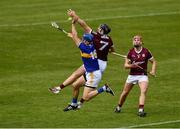 22 May 2021; John McGrath of Tipperary in action against Aidan Harte of Galway as Galway's TJ Brennan awaits developments during the Allianz Hurling League Division 1 Group A Round 3 match between Tipperary and Galway at Semple Stadium in Thurles, Tipperary. Photo by Ray McManus/Sportsfile