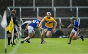 23 May 2021; Diarmuid Ryan of Clare in action against James Ryan, left, and Ciarán Collier of Laois during the Allianz Hurling League Division 1 Group B Round 3 match between Laois and Clare at MW Hire O'Moore Park in Portlaoise, Laois. Photo by Piaras Ó Mídheach/Sportsfile