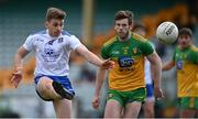 22 May 2021; Míchéal Bannigan of Monaghan in action against Eoghan Bán Gallagher of Donegal during the Allianz Football League Division 1 North Round 2 match between Donegal and Monaghan at MacCumhaill Park in Ballybofey, Donegal. Photo by Piaras Ó Mídheach/Sportsfile