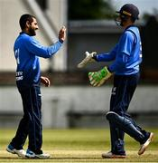25 May 2021; Simi Singh, left, of Leinster Lightning celebrates with team-mate Lorcan Tucker after bowling out William Porterfield of North West Warriors in action during the Cricket Ireland InterProvincial Cup 2021 match between North West Warriors and Leinster Lightning at Eglinton Cricket Club in Derry. Photo by David Fitzgerald/Sportsfile