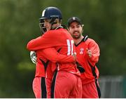 27 May 2021; Munster Reds players including Tyrone Kane, right, and PJ Moor celebrate the wicket of Harry Tector of Northern Knights during the Cricket Ireland InterProvincial Cup 2021 match between Munster Reds and Northern Knights at Pembroke Cricket Club in Dublin. Photo by Harry Murphy/Sportsfile