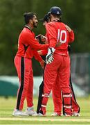 27 May 2021; Munster Reds players including Amish Sidhu, left, and PJ Moor celebrate the wicket of Harry Tector of Northern Knights during the Cricket Ireland InterProvincial Cup 2021 match between Munster Reds and Northern Knights at Pembroke Cricket Club in Dublin. Photo by Harry Murphy/Sportsfile