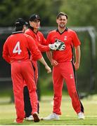 27 May 2021; Fionn Hand of Munster Reds, right, celebrates with team-mates after bowling out Mark Adair of Northern Knights during the Cricket Ireland InterProvincial Cup 2021 match between Munster Reds and Northern Knights at Pembroke Cricket Club in Dublin. Photo by Harry Murphy/Sportsfile