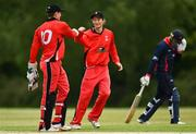 27 May 2021; PJ Moor, left, and Matt Ford of Munster Reds celebrate the wicket of Ben White of Northern Knights during the Cricket Ireland InterProvincial Cup 2021 match between Munster Reds and Northern Knights at Pembroke Cricket Club in Dublin. Photo by Harry Murphy/Sportsfile