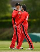 27 May 2021; Matt Ford, left, and Tyrone Kane of Munster Reds celebrate the wicket of Ben White of Northern Knights during the Cricket Ireland InterProvincial Cup 2021 match between Munster Reds and Northern Knights at Pembroke Cricket Club in Dublin. Photo by Harry Murphy/Sportsfile
