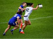 23 May 2021; Grace Clifford of Kildare in action against Fiona Dooley, behind, and Aoife Kirrane of Laois during the Lidl Ladies Football National League Division 3B Round 1 match between Laois and Kildare at MW Hire O'Moore Park in Portlaoise, Laois. Photo by Piaras Ó Mídheach/Sportsfile