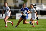 23 May 2021; Anna Healy of Laois in action against Aoife Rattigan, left, and Grace Clifford of Kildare during the Lidl Ladies Football National League Division 3B Round 1 match between Laois and Kildare at MW Hire O'Moore Park in Portlaoise, Laois. Photo by Piaras Ó Mídheach/Sportsfile
