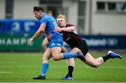 28 May 2021; Josh O'Connor of Leinster A is tackled by Jamie Osborne of Ireland U20 during the match between Ireland U20 and Leinster A at Energia Park in Dublin. Photo by Ramsey Cardy/Sportsfile