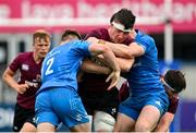 28 May 2021; Harry Sheridan of Ireland U20 is tackled by David Hawkshaw, left, and Marcus Kiely of Leinster A during the match between Ireland U20 and Leinster A at Energia Park in Dublin. Photo by Ramsey Cardy/Sportsfile