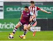 28 May 2021; Chris Lyons of Drogheda United in action against Cameron McJannet of Derry City during the SSE Airtricity League Premier Division match between Drogheda United and Derry City at Head in the Game Park in Drogheda, Louth. Photo by Eóin Noonan/Sportsfile