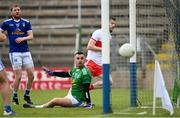 29 May 2021; Niall Loughlin of Derry shoots to score his side's first goal past Cavan goalkeeper Raymond Galligan during the Allianz Football League Division 3 North Round 3 match between Cavan and Derry at Kingspan Breffni in Cavan. Photo by Harry Murphy/Sportsfile