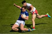 29 May 2021; Padraig Faulkner of Cavan in action against Ben McCarron of Derry during the Allianz Football League Division 3 North Round 3 match between Cavan and Derry at Kingspan Breffni in Cavan. Photo by Harry Murphy/Sportsfile