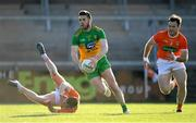 29 May 2021; Eoghan Bán Gallagher of Donegal gets past Ross McQuillan, left, and Ross Finn of Armagh during the Allianz Football League Division 1 North Round 3 match between Armagh and Donegal at the Athletic Grounds in Armagh. Photo by Piaras Ó Mídheach/Sportsfile