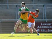 29 May 2021; Eoghan Bán Gallagher of Donegal gets past Ross McQuillan of Armagh during the Allianz Football League Division 1 North Round 3 match between Armagh and Donegal at the Athletic Grounds in Armagh. Photo by Piaras Ó Mídheach/Sportsfile