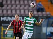 29 May 2021; Graham Burke of Shamrock Rovers in action against Paddy Kirk of Longford Town during the SSE Airtricity League Premier Division match between Longford Town and Shamrock Rovers at Bishopsgate in Longford. Photo by Seb Daly/Sportsfile