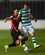 29 May 2021; Graham Burke of Shamrock Rovers is tackled by Karl Chambers of Longford Town during the SSE Airtricity League Premier Division match between Longford Town and Shamrock Rovers at Bishopsgate in Longford. Photo by Seb Daly/Sportsfile