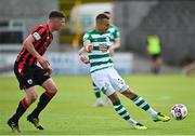 29 May 2021; Graham Burke of Shamrock Rovers in action against Aaron Robinson of Longford Town during the SSE Airtricity League Premier Division match between Longford Town and Shamrock Rovers at Bishopsgate in Longford. Photo by Seb Daly/Sportsfile
