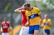 30 May 2021; Cathal O'Connor of Clare celebrates as Ian Maguire of Cork reacts during the Allianz Football League Division 2 South Round 3 match between Clare and Cork at Cusack Park in Ennis, Clare. Photo by Harry Murphy/Sportsfile