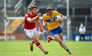 30 May 2021; Cathal O'Connor of Clare in action against Ian Maguire of Cork during the Allianz Football League Division 2 South Round 3 match between Clare and Cork at Cusack Park in Ennis, Clare. Photo by Harry Murphy/Sportsfile