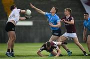 30 May 2021; Con O'Callaghan of Dublin blocks a clearance by Galway goalkeeper Bernard Power on his way to scoring his side's first goal during the Allianz Football League Division 1 South Round 3 match between Galway and Dublin at St Jarlath's Park in Tuam, Galway. Photo by Ramsey Cardy/Sportsfile