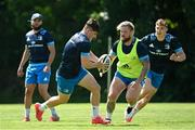 31 May 2021; Dan Sheehan, left, Andrew Porter and Garry Ringrose, right, during Leinster Rugby squad training at UCD in Dublin. Photo by Ramsey Cardy/Sportsfile