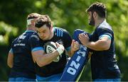 31 May 2021; James Ryan is tackled by Scott Penny, left, and Vakh Abdaladze during Leinster Rugby squad training at UCD in Dublin. Photo by Ramsey Cardy/Sportsfile